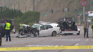 Authorities investigate a fatal crash that involved Bruce Jenner on PCH in Malibu Feb. 7, 2015. (Credit: KTLA)
