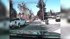 A house explosion was captured by a police officer's dashcam. (Credit: KYW-TV via CNN)