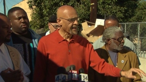 Earl Ofari Hutchinson is on Feb. 13, 2015, backed by other activists in calling for police training in the wake of the shooting of Jamar Nicholson. (Credit: KTLA)