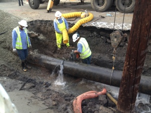 Workers prepare to remove a section of water main after a break occurred Feb. 18, 2015. (Credit: Kareen Wynter/KTLA)