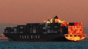 The union has blamed the shipping companies for the congestion, which it says stems from increased use of larger container ships and a shortage of trailers. (Credit: Bob Chamberlin/Los Angeles Times)
