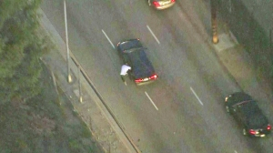 A pursuit suspect is seen trying to carjack a vehicle in East Los Angeles on Monday, Feb. 9, 2015. (Credit: KTLA)