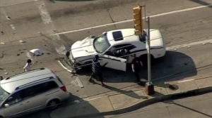 A high-speed police chase in Dallas ended when a mother whose minivan was hit got out of her vehicle and attacked the suspect. (Credit: CNN)