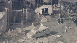 Ash-covered vehicles appeared to have been damaged in the fire at the ExxonMobil Torrance Refinery on Feb. 18, 2015. (Credit: KTLA)