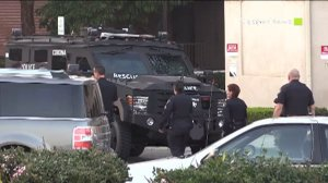 A SWAT truck responded at the site of a bank robbery that occurred in Corona on Feb. 4, 2015. (Credit: CasperNews)