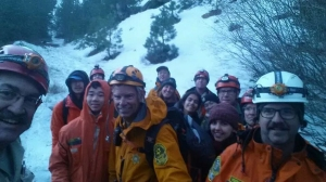 UCLA students are seen with members of a sheriff's search and rescue team in the San Gabriel Mountains on Sunday, Feb. 8, 2015.  (Credit: Los Angeles County Sheriff's Department)