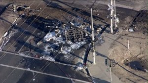 A vehicle is pictured after being struck by a train and becoming fully engulfed in flames on Feb. 24, 2015. (Credit: KTLA)
