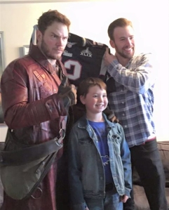 Marvel stars Chris Pratt, left, and Chris Evans, right, pose with a child at a Boston children's hospital on Feb. 6, 2015. The photo was tweeted by the Seahawks and distributed through the CNN Wire.