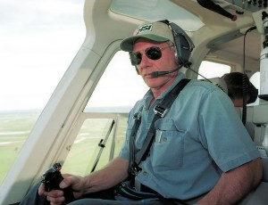 Actor Harrison Ford flies his helicopter July 10, 2001, near Jackson, Wyoming. (Credit: Getty Images)
