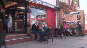Clabe Hartley sits in front the Cow's End on March 23, 2015, two days after a transient bit his finger off at the Venice cafe. (Credit: KTLA)