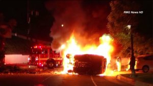 Street racing led to a fiery crash in Beverly Crest on Saturday, March 28, 2015, police said. (Credit: RMG News)