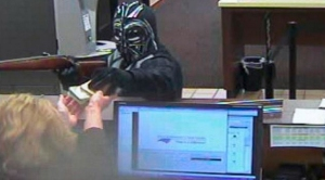 """Not only was the robber wearing a mask, he was also sporting a chest plate and gloves similar to those worn by the """"Star Wars"""" character. (Credit: Pineville Police Department)"""