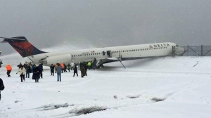 A plane slid off the runway at LaGuardia Airport in New York on Thursday, March 5, 2015. (Credit: @steveblaze98 via Twitter)