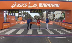 Kenyan Daniel Limo, 31, crosses the L.A. Marathon finish line on Sunday, March 15, 2015. (Credit: KTLA)