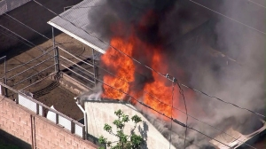 A fire burned at a home in Burbank on March 20, 2015. (Credit: KTLA)