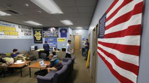 The American flag has been rehung on the wall of the UC Irvine student government center days after a student government decision to ban all flags from this office set off a firestorm of protests from students and the public. The ban was vetoed March 7, 2015. (Credit: Don Bartletti / Los Angeles Times)