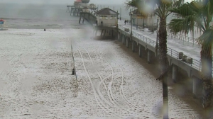 Pea-sized hail covered Huntington Beach Monday morning. (Credit: KTLA)