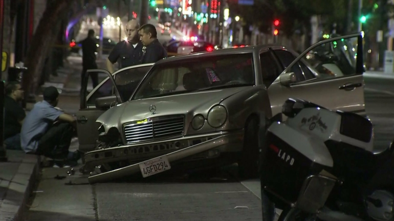 A damaged Mercedes is seen after hitting a pedestrian in Hollywood on March 27, 2015. (Credit: KTLA)