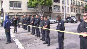 Los Angeles Police Department officers are seen in downtown after a police shot and killed a man on Sunday, March 1, 2015. (Credit: KTLA)