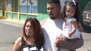 With her husband and young daughter beside her, Maria Uriostegui described being hit by a car after confronting diners about their unpaid bill. (Credit: KTLA)