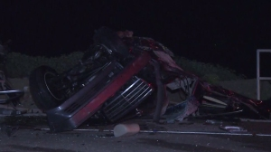 A Mercedes-Benz split into two following a head-on crash on PCH Tuesday, March 17, 2015. (Credit: KTLA)