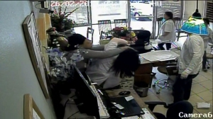 Surveillance footage showed a fight between a salon owner and a customer over nail polish.