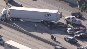 A semitrailer and 11 other vehicles were involved in a crash on the 10 Freeway in Ontario on Wednesday, March 25, 2015. (Credit: KTLA)