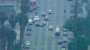Police pursued a stolen vehicle through South L.A. surface streets on March 11, 2015. (Credit: KTLA)