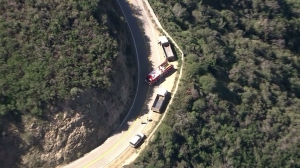 A truck was stopped at the scene of a fatal collision on Glendora Mountain Road on March 20, 2015. (Credit: KTLA)