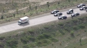 A pursuit that lasted more than an hour came to a stop on the transition road from the eastbound 210 Freeway to the northbound 15 Freeway on March 3, 2015. (Credit: KTLA)