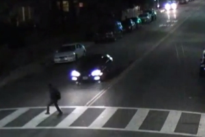 A still from surveillance video released by LAPD shows a vehicle speeding toward Elias Aceves, who was killed March 10, 2015, near USC.
