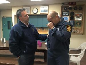 A photo released by Los Angeles City Councilman Joe Buscaino shows him standing with Los Angeles Firefighter Miguel Meza, who responded to a fatal crash at the Port of Los Angeles on Thursday, April 9, 2015. Credit: Joe Buscaino/Facebook)