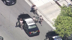 A woman was taken into custody after a pursuit ended in Pasadena on April 15, 2015. (Credit: KTLA)