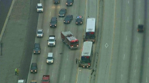 Los Angeles County Sheriff's Department buses are seen on the 170 Freeway following a crash. (Credit: KTLA)