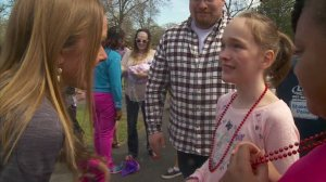 Mackenzie Moretter, in pink, celebrated her birthday with hundreds of strangers after her classmates declined her party invitation. (Credit: WCCO/CNN)