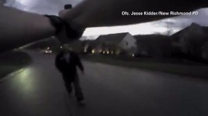 Officer Jesse Kidder, of the New Richmond Police Department in Ohio, pointed his gun at a suspect during a confrontation on Thursday, April 16, 2015. (Credit: New Richmond Police Department/CNN)