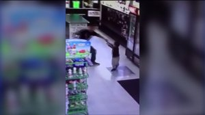 Surveillance video shows a man slapping a boy in a Bakersfield grocery store. (Credit: Facebook)