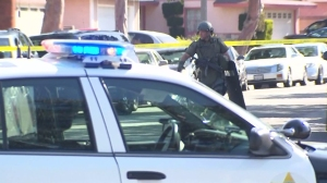 A married couple was found dead following an eight-hour barricade in Carson on April 12, 2015. (Credit: KTLA)