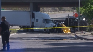 Hours after the fatal crash below the 210 Freeway on April 17, 2015, investigators remained on scene. (Credit: KTLA)