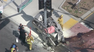 A pole appeared to have cut through a minivan that was involved in a traffic collision in Hawthorne on April 2, 2015. (Credit: KTLA)