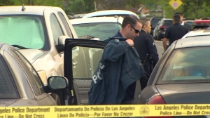 LAPD investigators respond to a home where an 8-year-old boy was shot in Del Rey on April 5, 2015. (Credit: KTLA)