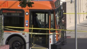 Police tape surrounded a Metro bus in Echo Park after a shooting that left the driver with a graze wound on Sunday, April 5, 2015. (Credit: KTLA)