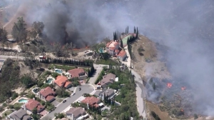 A home on Highwater Road appeared to be threatened by fire on April 27, 2015, in Granada Hills. (Credit: KTLA)