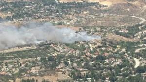 A vegetation fire threatened Granada Hills homes on April 27, 2015. (Credit: KTLA)