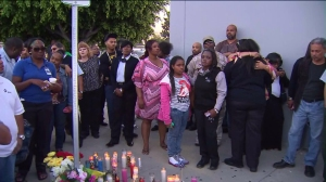 Friends, family and co-workers gathered at the site of the shooting in Hawthorne to remember 44-year-old Denise Berry on April 3, 2015. (Credit: KTLA)