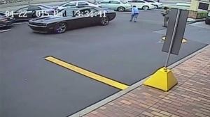 Huntington Beach police released this video of an elderly woman being struck in a McDonald's parking lot.