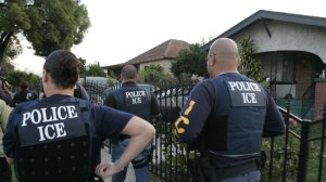 Immigration and Customs Enforcement agents on a raid in Los Angeles. (Credit: Allen J. Schaben / Los Angeles Times)