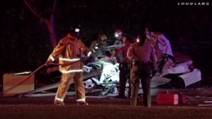 Two men were killed and a woman badly injured in a crash in La Puente on April 5, 2015. (Credit: Loudlabs)