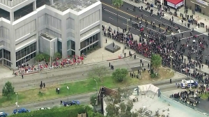 Turkish and Armenian demonstrators are seen near the Turkish Consulate in Mid-Wilshire. (Credit: KTLA)
