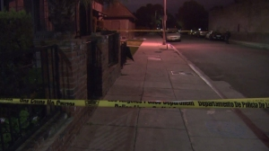 Hours after a fatal shooting in West Adams, police tape continued to surround the scene early Friday morning, April 24, 2015. (Credit: KTLA)